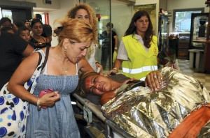 Survivors of the terror attack on the Israeli tour bus in Burgas, Bulgaria, returning to Israel with the help of the Israeli Air Force, July 19, 2012. (Yossi Zeliger/FLASH90/JTA)