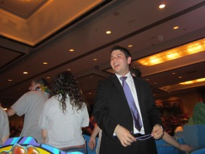USY international president Michael Benjamin Sacks rides a float inside the Hilton Hotel at opening ceremonies for IC NOLA (Photo by Alan Smason)