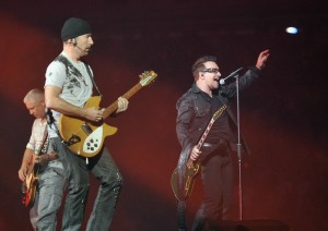 EAST RUTHERFORD, NJ - JULY 20: (L-R) U2 bass player Adam Clayton, guitar player The Edge and lead singer Bono perform at the New Meadowlands Stadium on July 20, 2011 in East Rutherford, New Jersey.  (Photo by Mike Coppola/Getty Images)
