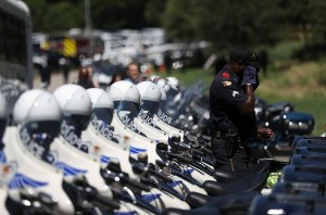DALLAS, TX - JULY 14:  A Dallas police officer wipes his face as he arrives at the funeral for slain Dallas police Sgt. Michael Smith at The Watermark Church on July 14, 2016 in Dallas, Texas. Dallas police Sgt. Michael Thomas was one of five Dallas police officers who were shot and killed by a sniper during a Black Lives Matter march in Dallas.  (Photo by Justin Sullivan/Getty Images)