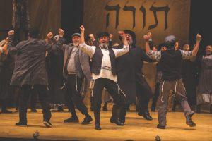 "Steven Skybell, center, as Tevye in the NYTF's original production of ""Fidler Afn Dakh"" (""Fiddler on the Roof""). (Photo courtesy NYTF)"