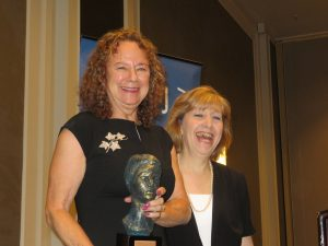 Susan Hess, left, holds the Hannah G. Solomon Award with NCJW event chair Kathy Shepard at her left. (Photo by Alan Smason)