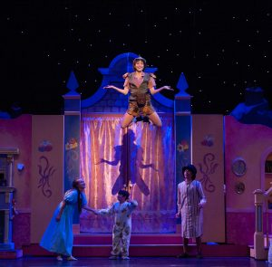 Shelbie Mac as Peter Pan with Bree Hollis, Cayden Pecoraro and Ethan Rogers as the Darling children Wendy, Michael and John. (Photo by John Barrois)
