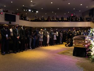 MINNEAPOLIS, MN - JUNE 04: People gather for a memorial service at North Central University pause silently for eight minutes and 46 seconds in honor of George Floyd on June 4, 2020 in Minneapolis, Minnesota. Memorial services will also be held in North Carolina and Texas. (Photo by Stephen Maturen/Getty Images)