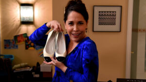 """A woman and her shoes. Andréa Burns stars as Haley in Theresa Rebeck's one-hander """"Bad Dates."""" (Photo courtesy George Street Playhouse)"""